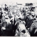 A crowd gathers for the re-opening of the South Fork Bridge, Gold Bridge B.C. in 1941. One man appears oddly out of place