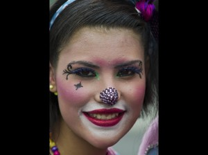 A clown smiles during a pilgrimage to the Virgin of Guadalupe's basilica, Mexico's patron saint, in Mexico City on July 18, 2012. Hundreds of clowns take part in the annual pilgrimage to the sanctuary of the Virgin.