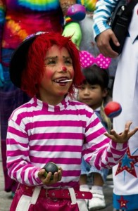 A child clown juggles with three balls during a pilgrimage to the Virgin of Guadalupe's basilica, Mexico's patron saint, in Mexico City on July 18, 2012. Hundreds of clowns take part in the annual pilgrimage to the sanctuary of the Virgin.