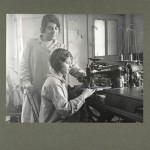 Learning to operate Singer sewing machine, vintage photo