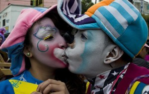 """Clowns """"Coquetin"""" (R) and """"Coqueta"""" kiss during a pilgrimage to the Virgin of Guadalupe's basilica"""