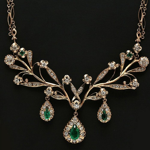 Gold necklace with emeralds and diamonds. She favored rare one-off pieces, in particular diamonds and emeralds of high calibre and size, some of these rare pieces were given to her by the heads of states