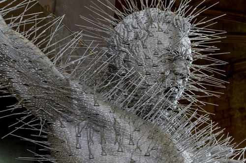 Golgotha, detail. Coat hangers and steel sculpture by David Mach