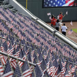 Volunteers and participants in the parade marched around the field at the stadium, Huntington Park during a ceremony to commemorate the victims of the September 11 attacks, Columbus, Ohio, USA