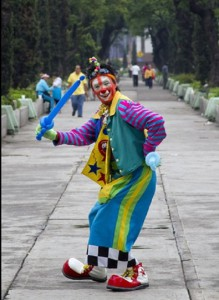 A clown poses as he takes part in the pilgrimage to the Virgin of Guadalupe's basilica, Mexico's patron saint, in Mexico City on July 18, 2012.