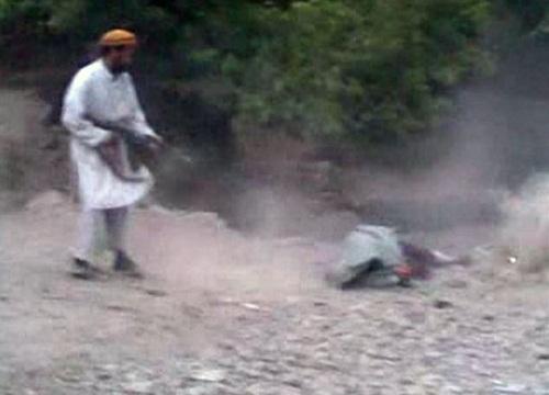Helpless Afghan woman gunned down