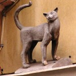 Vasilisa, the cat in St. Petersburg, on Malaya Sadovaya. Miniatures installed in memory of the blockade cats, imported from the Yaroslavl region in order to save the city from the rats