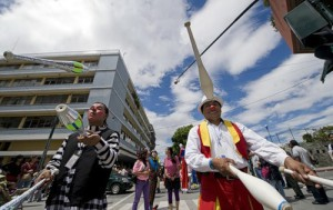 Clowns perform during a parade in the historic centre of Guatemala City in the framework of the IV Latin American Clown Congress on July 24, 2012