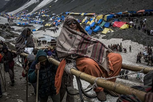 carried on palanquins by Kashmiri bearers over a glacier