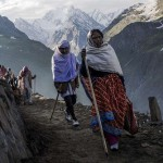 Women pilgrims walk along a mountain path as they make their pilgrimage to the sacred Amarnath Cave