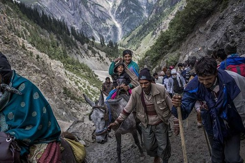 Lots of Hindu pilgrims line-up for a meal at a Lungar facility providing free food to pilgrims, during their pilgrimage to the sacred Amarnath Cave