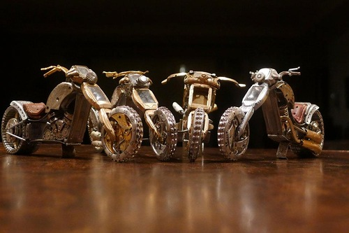A set of Miniature motorcycles from vintage watch parts, made by Dan Tanenbaum, Canada