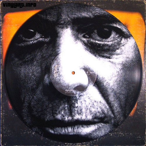 Portrait of Lou Reed hand-painted on a vinyl LP by Daniel Elden
