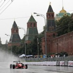 Russian racing driver Natalie Freidina drives past the Kremlin during the Moscow City Racing exhibition event July 17, 2011