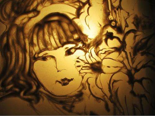 Sand artist Alyona Voynova