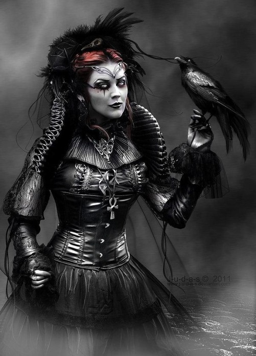 """Beautiful Gothic image of a woman with a black crow. Titled """"c_o_r_v_u_s_c_o_r_a_x_by_j_u_d_a_s"""". Digital art by British artist Paul"""