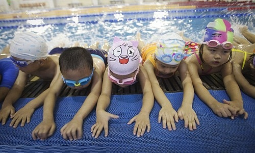 Young boys and girls are put through their paces at the Chen Jinglun Sports School, the alma mater of Ye Shiwen
