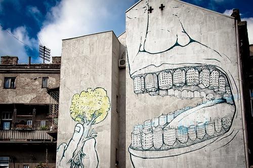 Cities swallowing trees. Art by Blu in Belgrade, Serbia