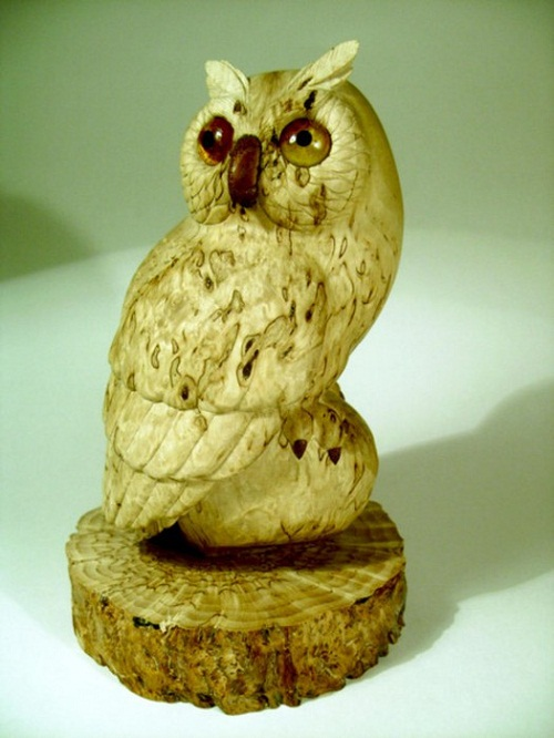 Decorative sculpture of an owl of Karelian birch, with inlaid amber and mahogany. Work by Russian sculptor wood carver Andrew Skorobogatyi