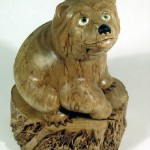 Bear miniature sculpture. Wood carving. Karelian birch. Work by Russian artist Andrew Skorobogatyi