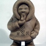 Yakut man (Northern people). Karelian birch miniature sculpture by Russian artist Andrew Skorobogatyi