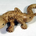 Lizard. Miniature decorative figurine of the Karelian birch, with inlaying boxwood and buffalo horn. Work by Karelian wood carver Andrew Skorobogatyi