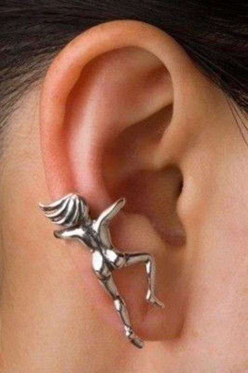 Naked girl, silver earrings