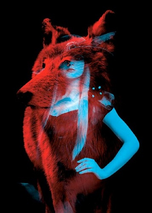 "A wolf and a model. Red and blue installation by French duo ""Helmo"" Thomas Couderc and Clement Vauchez"