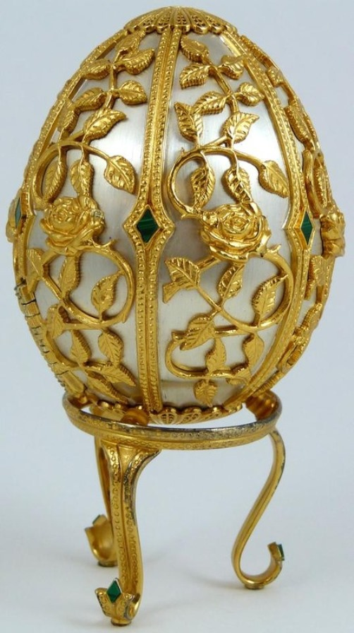 Beautiful Sterling Silver Egg by the House of Faberge, set with diamond shaped malachite stones.
