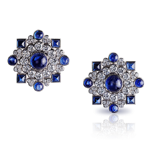 Dentelle de Perles Ear Studs. A mosaic of diamonds, recalling soft white embroidered summer dresses, set with 16 blue cabochon sapphires, totalling 16.9 carats. This piece is set in 18 carat white gold and features 91 diamonds, cabochon sapphires and ruby totalling 16.9 carats.