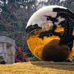 A huge glass ball installed on the grass meadow. Japanese miracle – Hakone Open-Air Art Museum