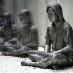"""Meditating woman sculpture. Located in the open-air museum """"Hakone"""", Japan"""