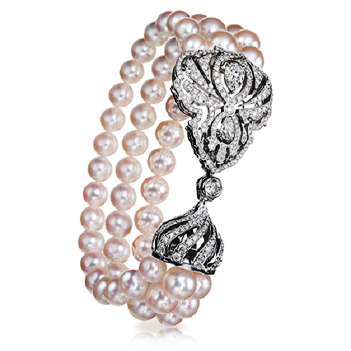Imperial Crest Bracelet. Three rows of fine round white pearls are clasped with a diamond set motif, combining an aristocratic crest, set with pear shaped diamonds and a spiralling diamond set cupola. The rich use of pearls refers to the passion for pearls that was such a feature of the Belle epoque, in Russia as in Europe