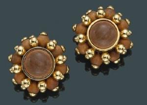 A pair of sandalwood and eighteen karat gold earclips, Verdura.