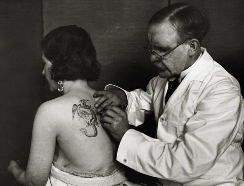 Tattoo Artist Tattoos Woman. ca. 1930, England, UK