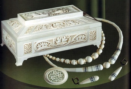 Jewelry box and decorations. Traditional Russian craft Kholmogory bone carving
