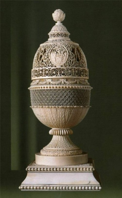 A cup. Bone carving