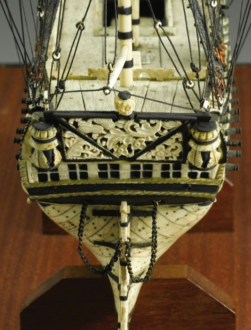 Ship's stern, decorated with bone carvings. British Navy ship models of human bones
