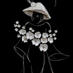 A lady in a hat carrying flowers