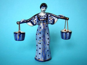 A woman with a yoke and buckets. Porcelain sculpture, blue gzhel
