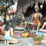 A couple of sinners standing on kneels in anticipation of the verdict of the judges. The Hell Garden in Thailand