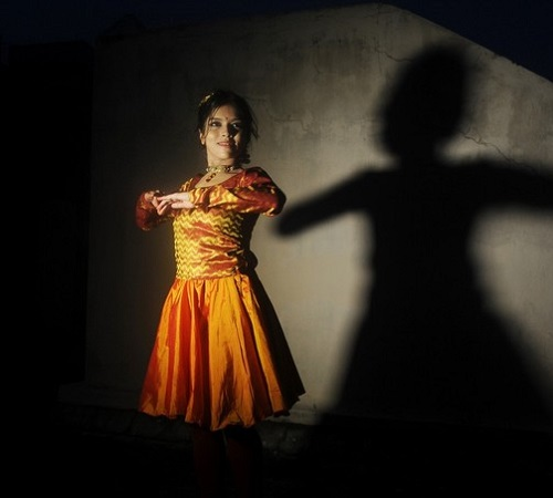 Indian Kathak dancer Chirasree Dasgupta, 22, performs during a demonstration to photographers following her world record in Kathak dance spinning in Kolkata on August 23, 2012.