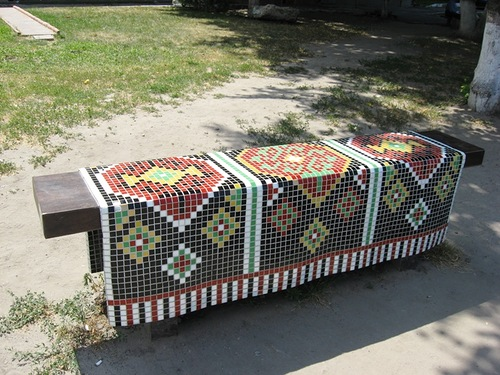 Mosaic carpet on the bench. Landscape alley urban project by sculptor Konstantin Skretutsky