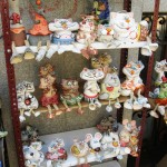 Souvenire stall with porcelain figurines of cats and mice. Landscape alley urban project by sculptor Konstantin Skretutsky