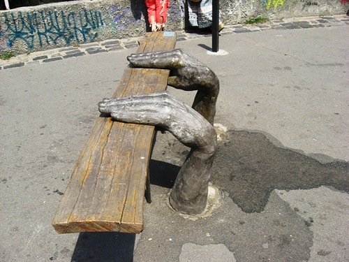 A bench with hands. Landscape alley urban project by sculptor Konstantin Skretutsky