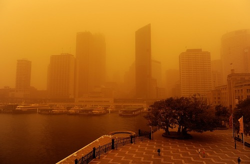 Sydney skyscrapers lost in the red mist. Martian landscape caused by dust storms in Australia