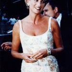 Princess Diana wears Verdura's diamond and gold 'Double-Crescent' bracelet and pearl, diamond and gold earclips to the sale of her clothes at Christies, June 1997