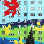 Christmas tree in front of a colorful house. Ramenskoye