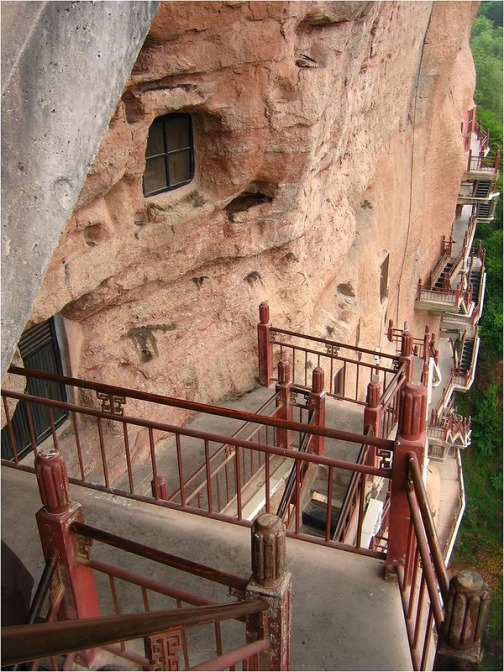 New metal constructions replaced old wooden stairs. Masterpiece of cave architecture – The Maijishan Grottoes. Gansu Province, China