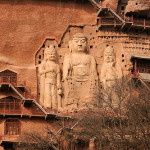 Three statues of Buddhas carved right from the rock. The Maijishan Grottoes. Gansu Province, China